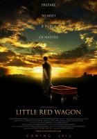 Chłopiec z czerwonym wózkiem